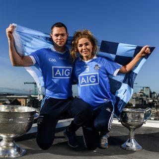 Dublin's Sinead Finnegan and Dean Rock At AIG HQ With All Ireland Trophies