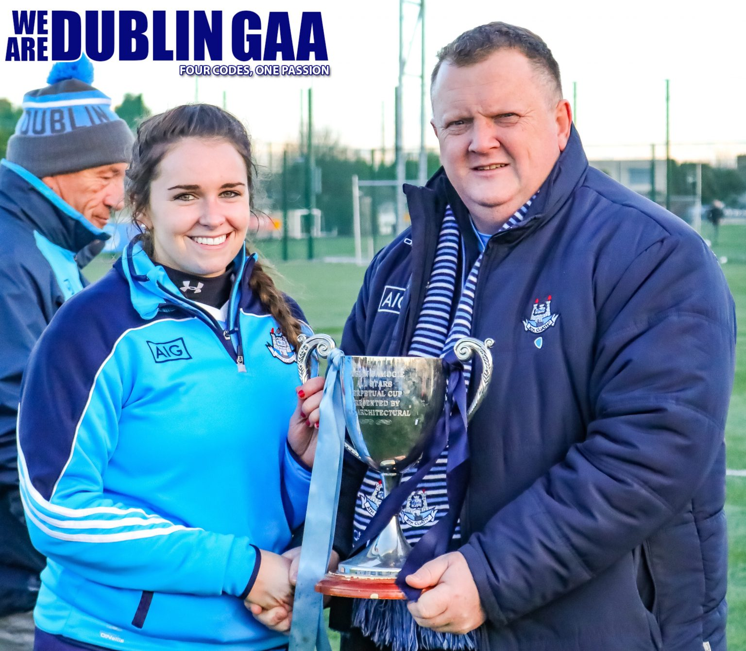 Dublin Captain Ali Twomey Is Presented With The Senior Dubs Stars Trophy By County Chairman Pat Martin