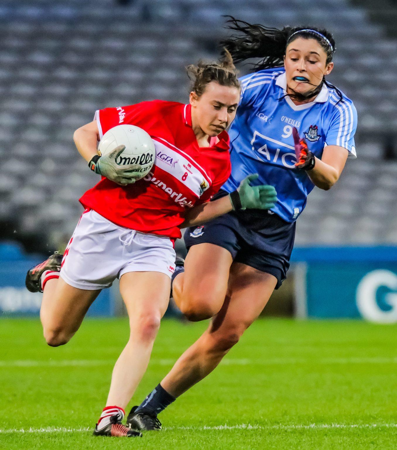 Dublin Midfielder Olwen Carey Putting In A Tackle On Cork's Melissa Duggan