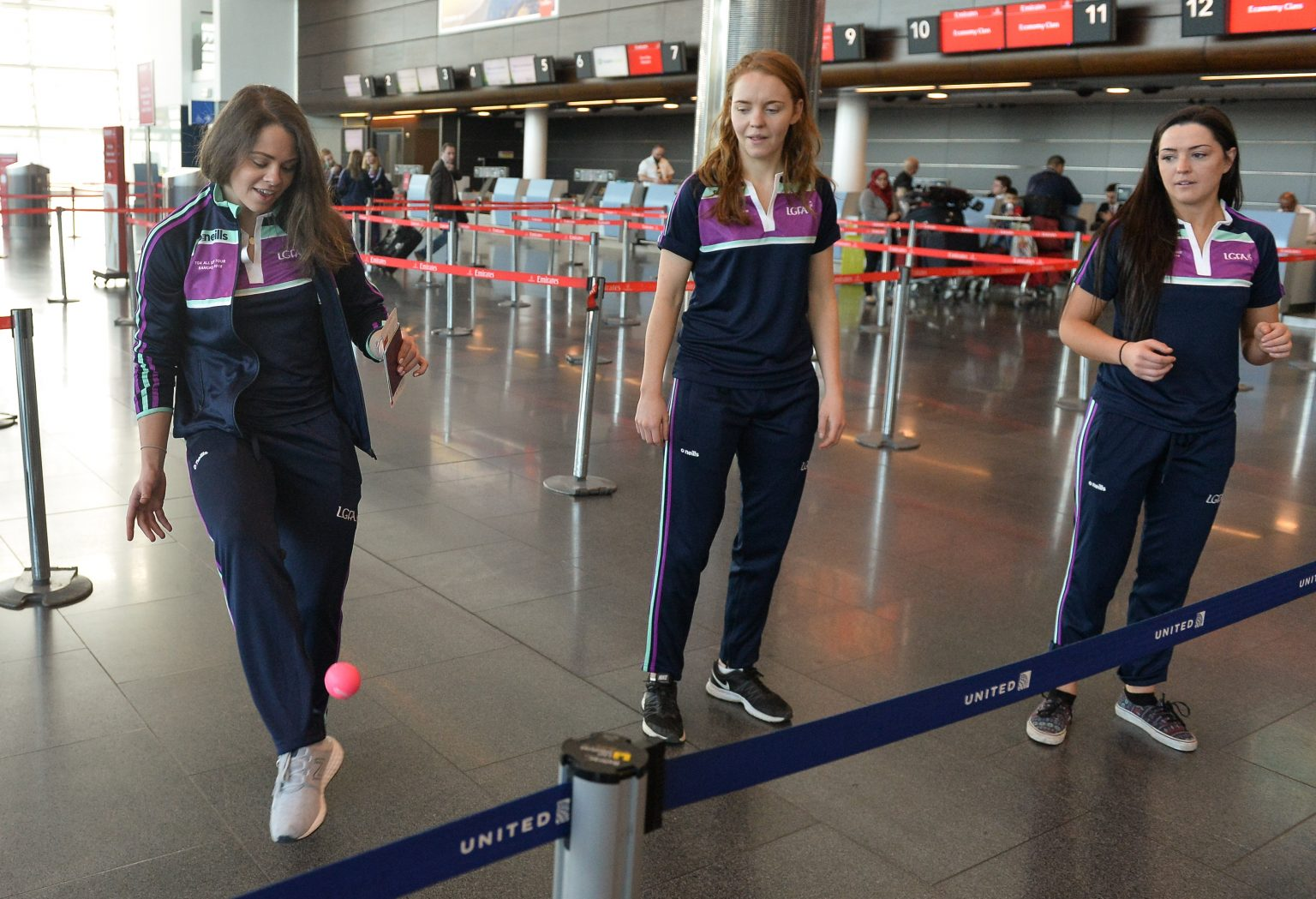 Dublin players, from left, Noelle Healy, Ciara Trant and Sinéad Goldrick playing keepie uppie ahead of the TG4 Ladies Football All-Star Tour departure to Bangkok at Dublin Airport, Dublin. Photo by Piaras Ó Mídheach/Sportsfile