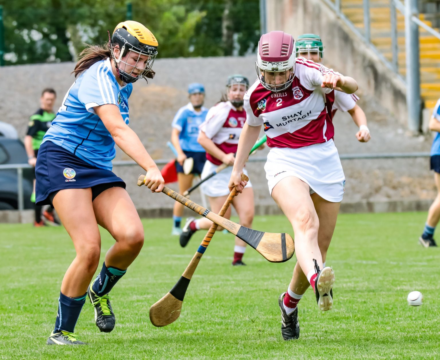A Westmeath Camogie Player kicks the ball away from a Dublin Player in a sky blue jersey in the final which Westmeath won to claim the Leinster title