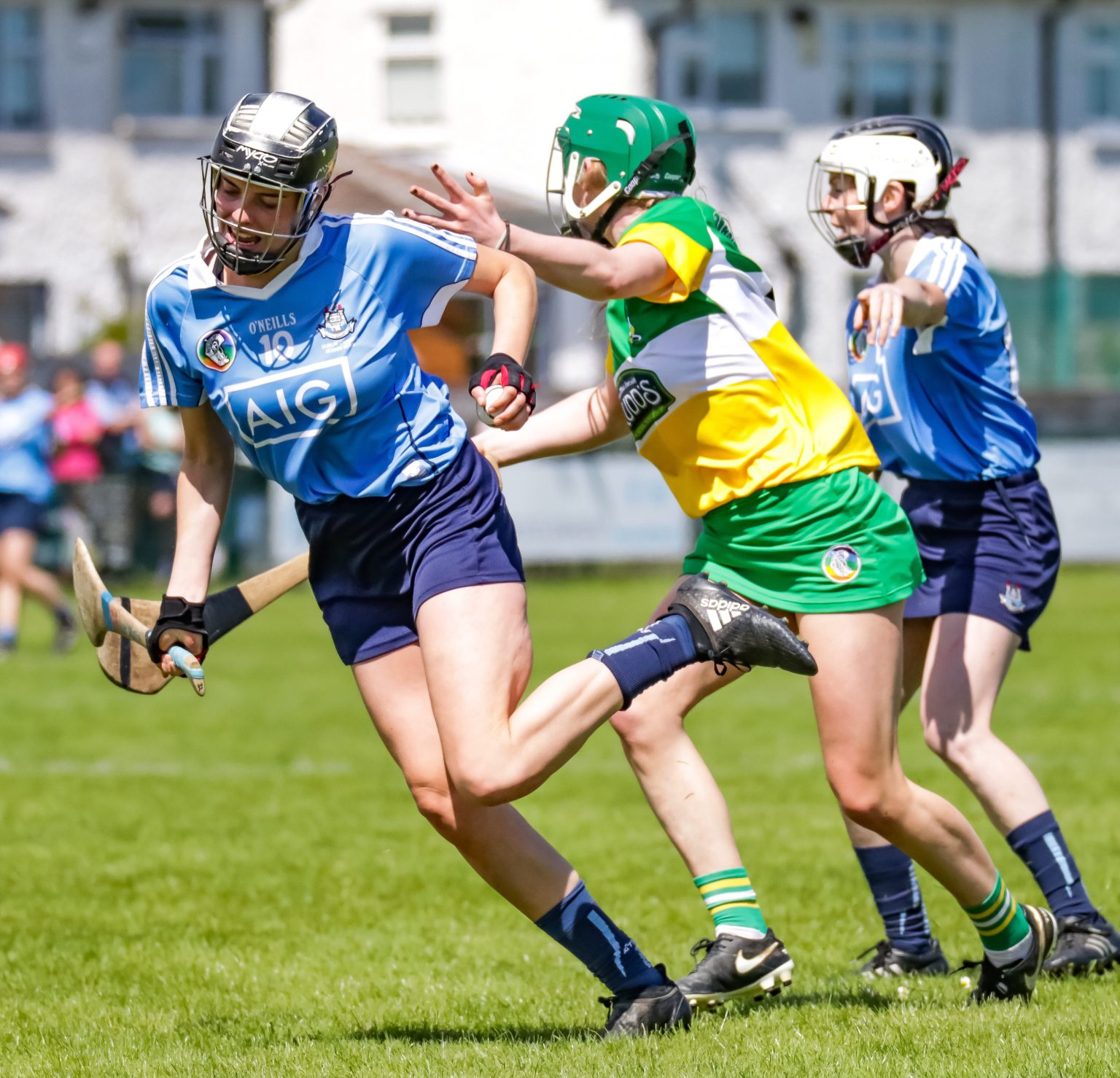 Dublin Camogie Player Alex Griffin in a sky blue jersey breaks away from an Offaly defender in a green, white and yellow jersey as Dublin's Leinster heartache continued in their loss to Offaly