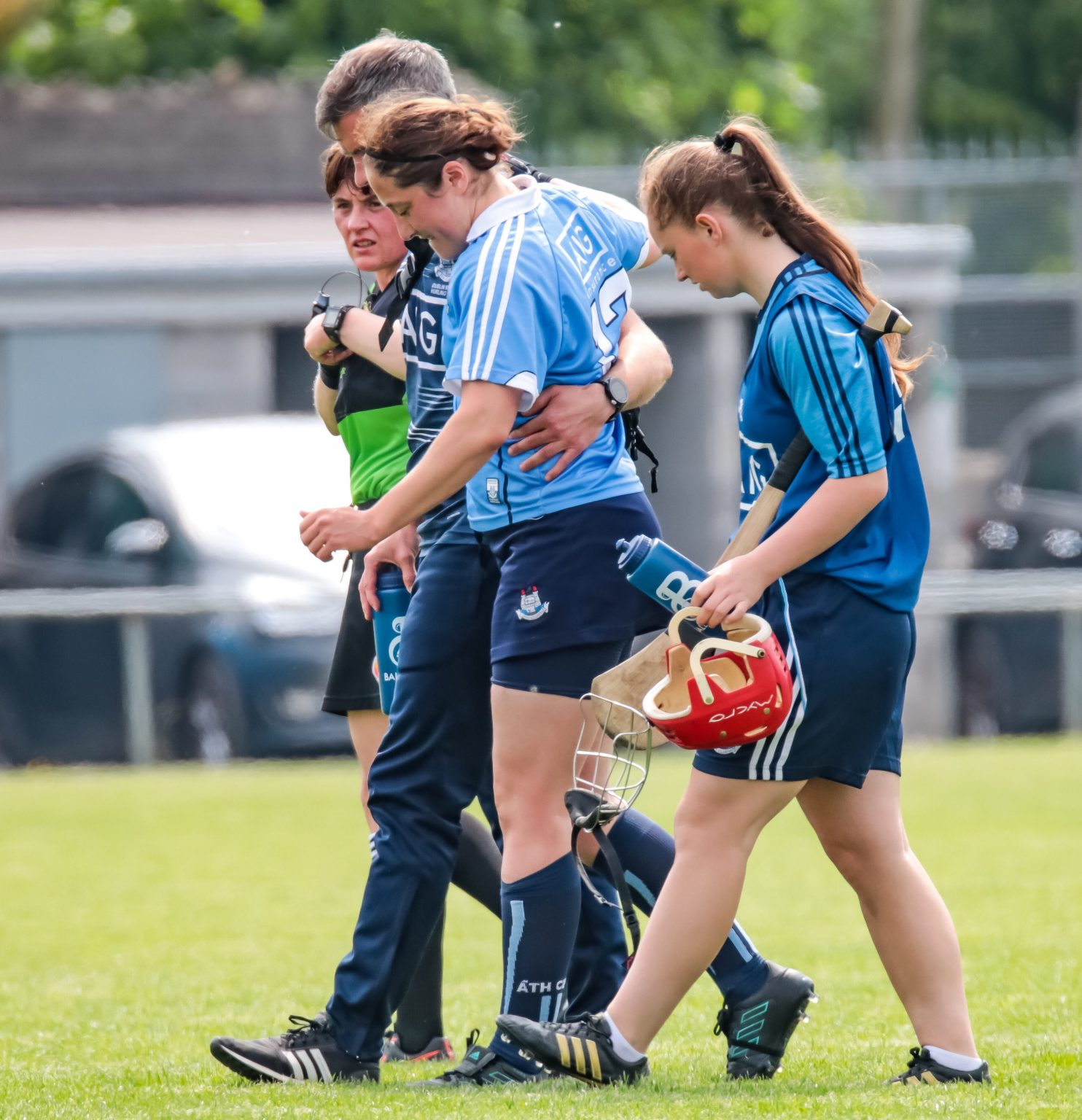 Dublin Captain In Sky Blue Jersey is helped off the pitch after injuring her knee