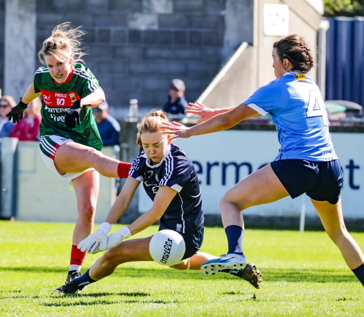 Dublin goalkeeper Ciara Trant in a Navy Jersey and Defender Leah Caffrey In a Sky Blue Jersey block a shot at goal in Dublin's Final Win as they lift first ever Division 1 League Title