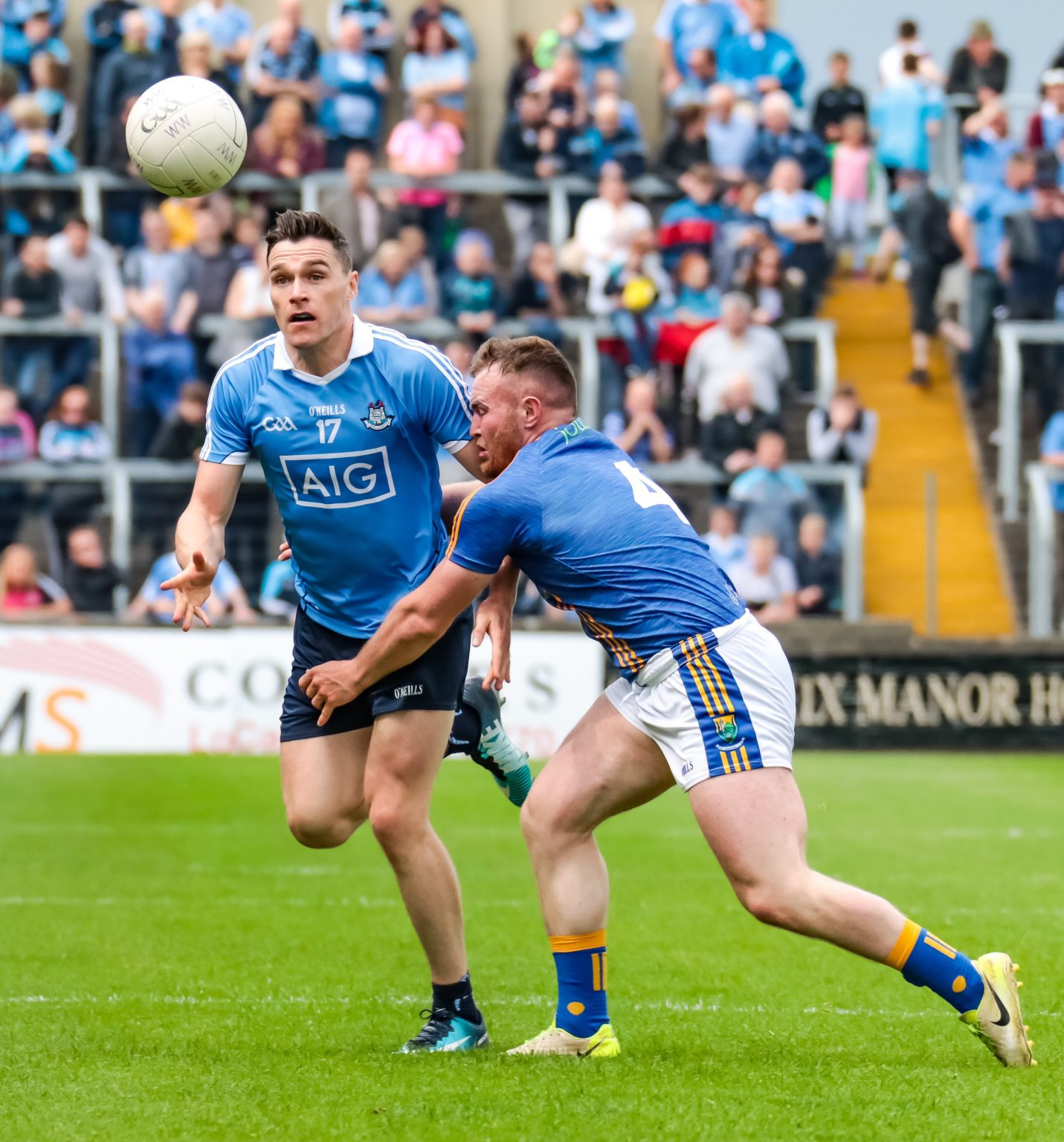 A dublin Player In a Sky Blue Jersey Battles for the ball with a wicklow Player In dark blue jersey with three yellow stripes and white shorts in Championship opener