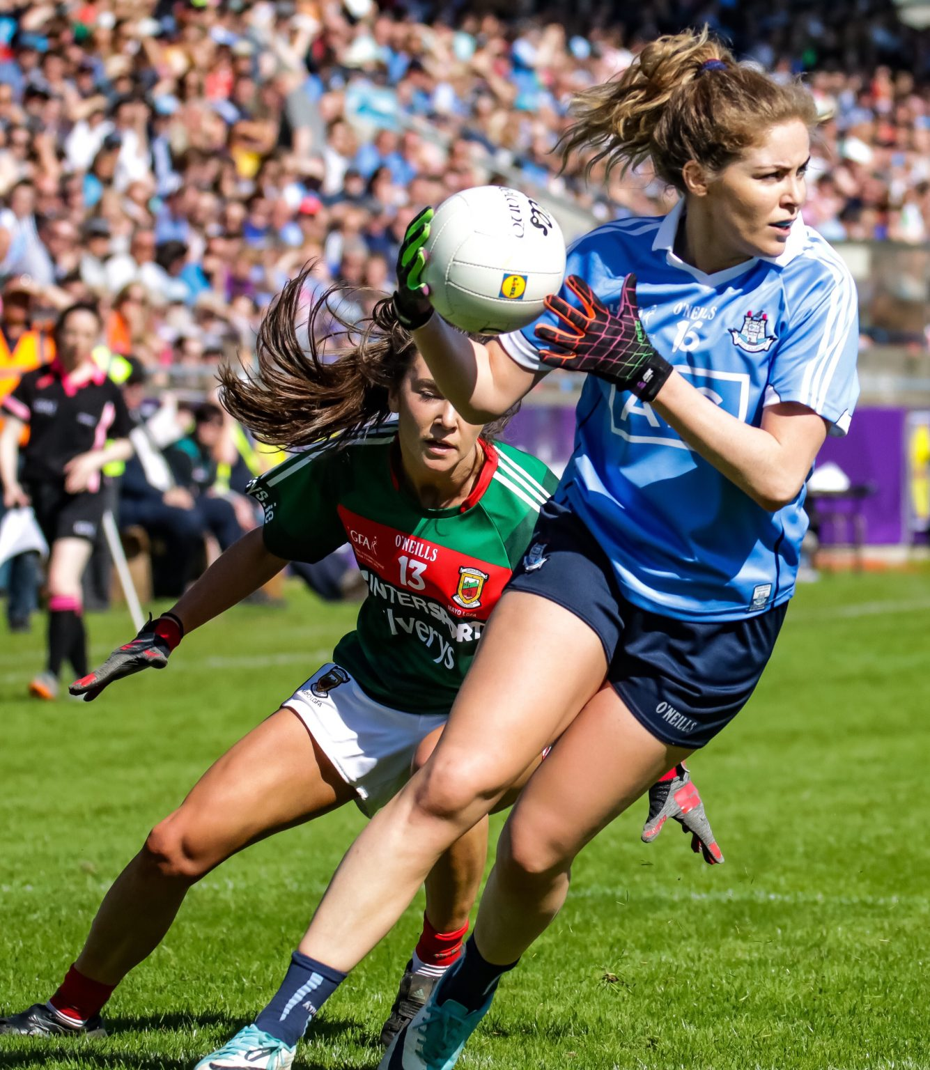 Dublin defender Sinead Finnegan In Sky Blue Jersey Breaks Out Of Defence With White Ball During Dublin's victory and first ever Division 1 League Title