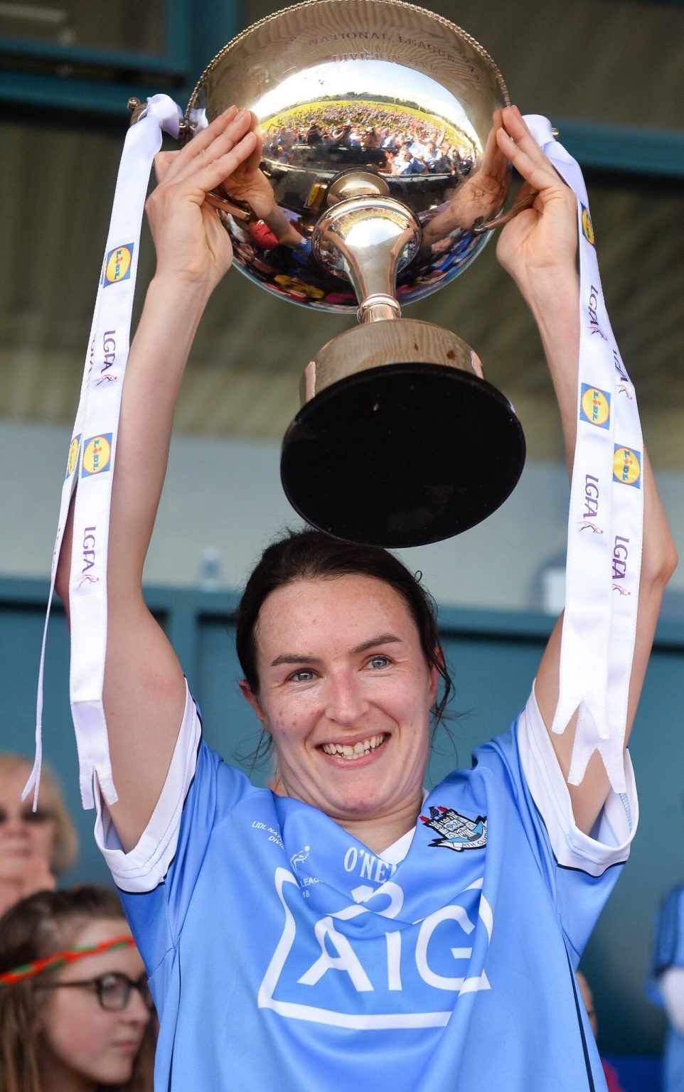 Captain Fantastic Sinead Aherne In A Sky Blue Dublin Jersey Lifts The National Football League Division 1 Trophy Abover Her Head