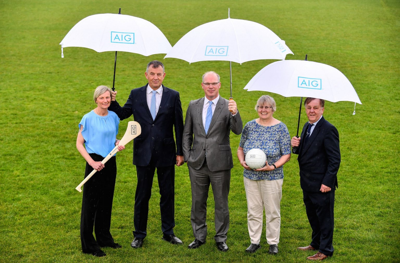 Dublin Camógie Chairwoman Jenny Byrne, Dublin GAA CEO John Costello, AIG General Manager Declan O'Rourke,Dublin LGFA Secretary Mary O'Connor and Dublin County Board Vice-Chairman Mick Seavers On A Green Pitch at the announcement of AIG extending their sponsorship of Dublin GAA