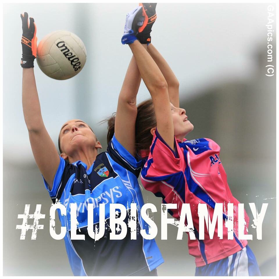 Two Dublin LGFA Players Jump one in a blue jersey and the other in a pink jersey to challenge for the ball during an adult club game