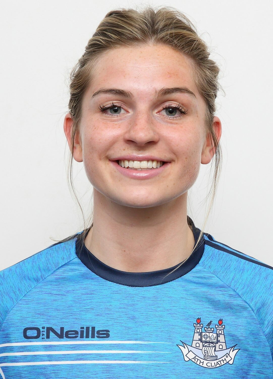 Headshot of Dublin defender Martha Byrne in a blue training top with the Dublin crest on the left hand side at the announcement Martha was named on the Lidl team of the league