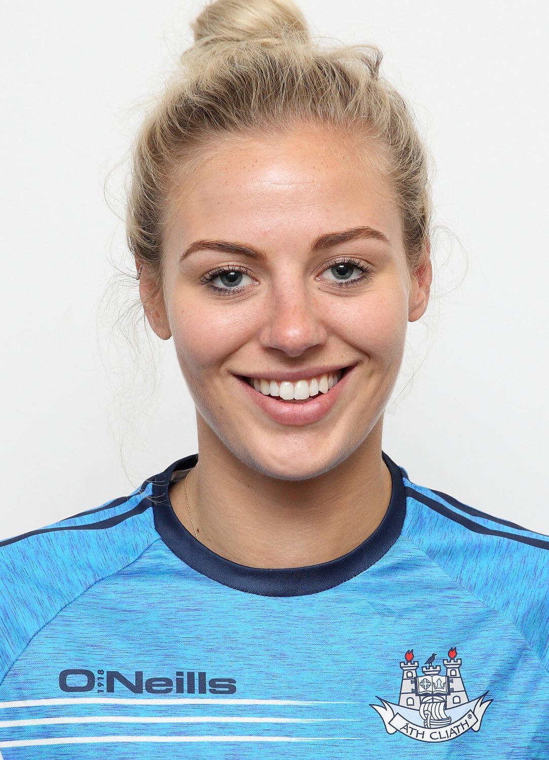 Headshot of Dublin forward Nicole Owens in a blue training top with a Dublin crest on the left hand side at the announcement that Nicole was named on the Lidl team of the league