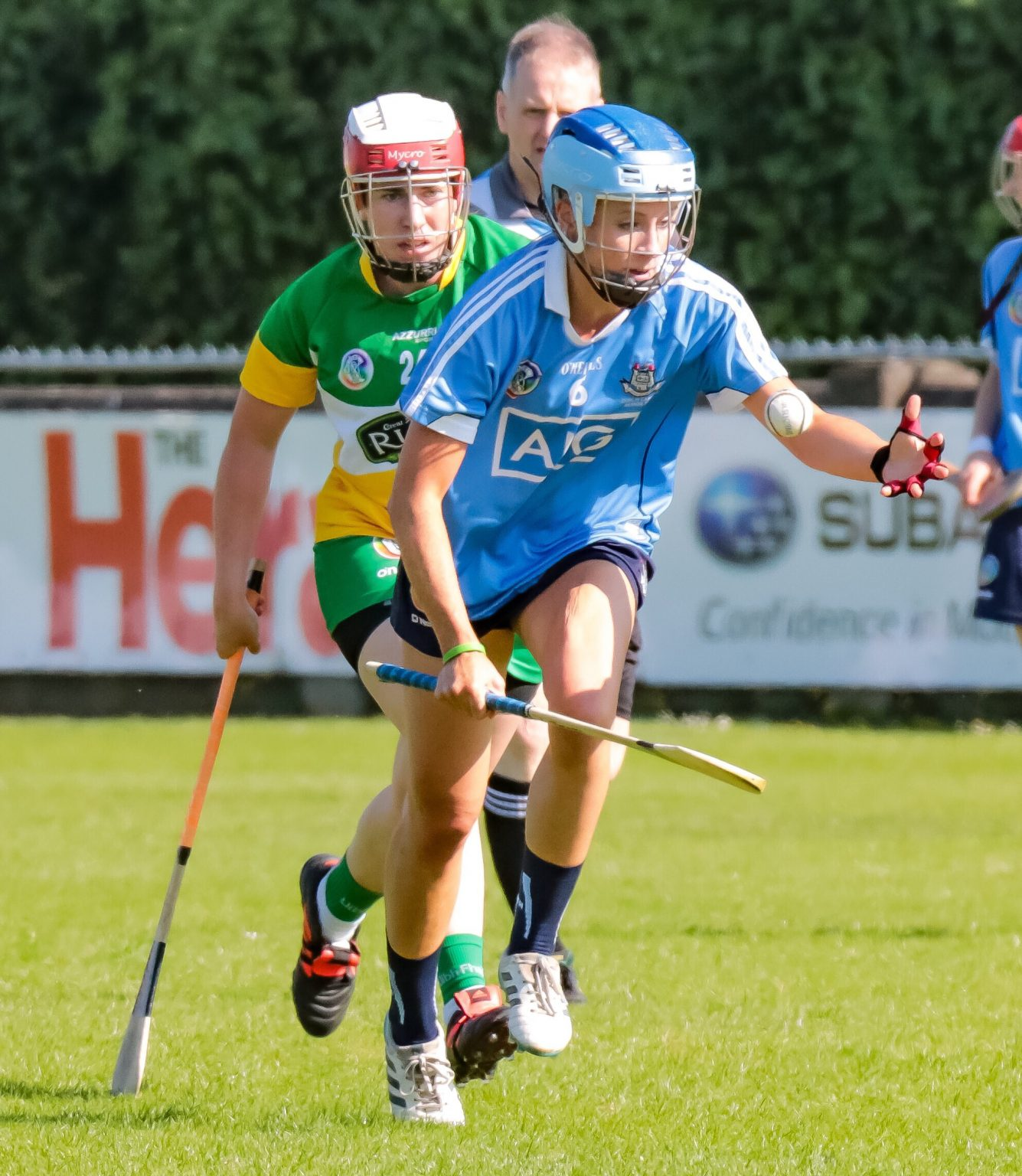 Dublin Camogie Player In Sky Blue Jersey and hurl in right hand breaks away with the ball during Dublin's Championship thriller win