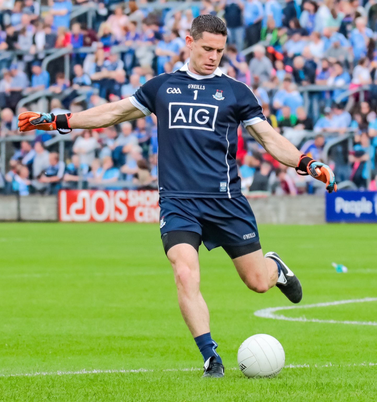 Dublin captain Stephen Cluxton in a navy jersey and shorts kicking a white ball off the ground with his side set to make a new record