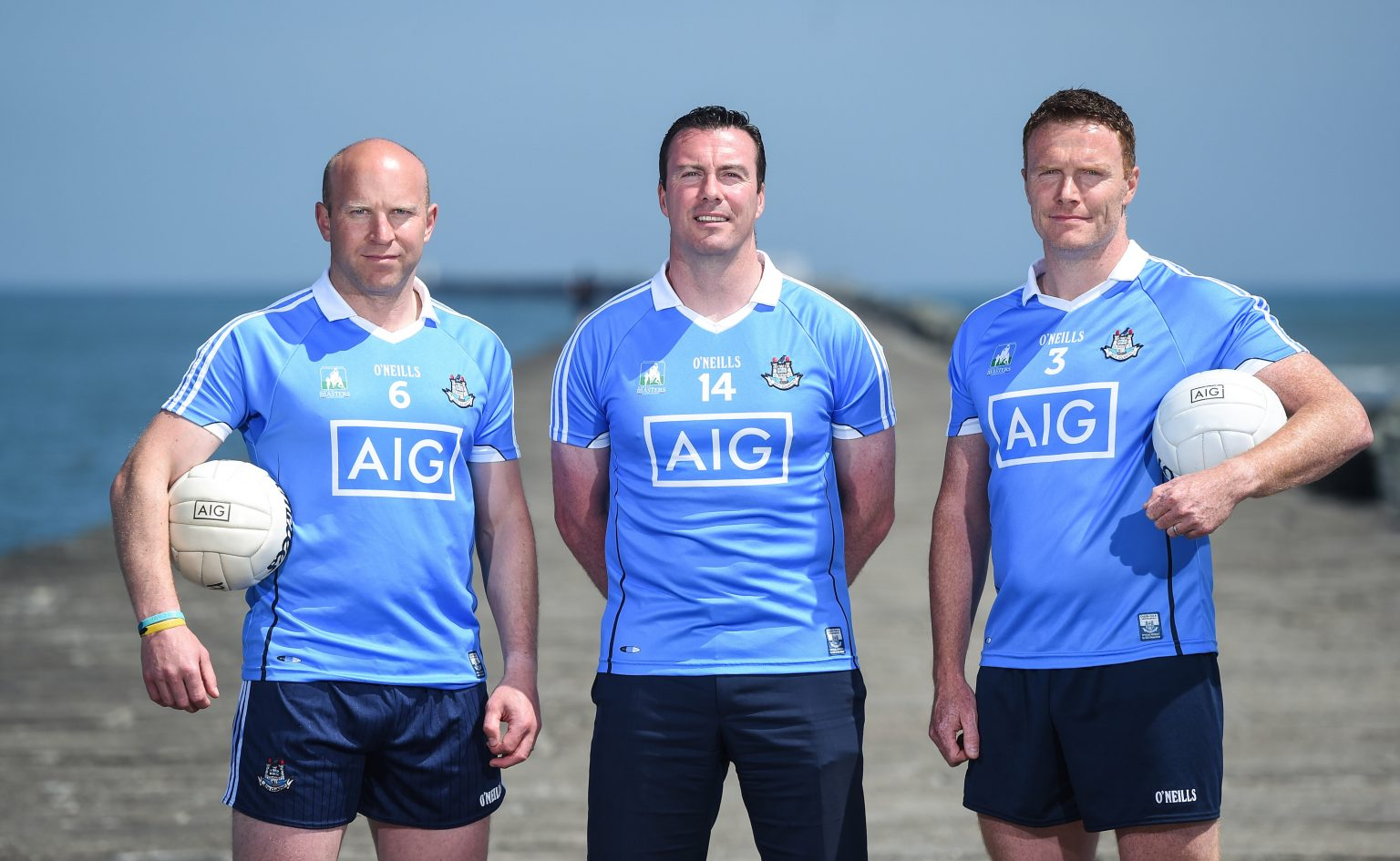 24a43c693b0 Three Former Dublin Players In Sky Blue Jersey's Pose with a white ball  under their arm