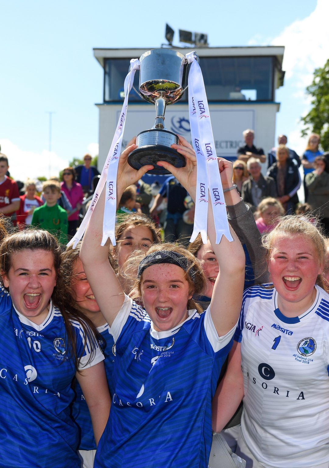 A group of Cavan Players in navy jerseys celebrating with the All ireland trophy after goals in either have helped them beat Dublin in the final
