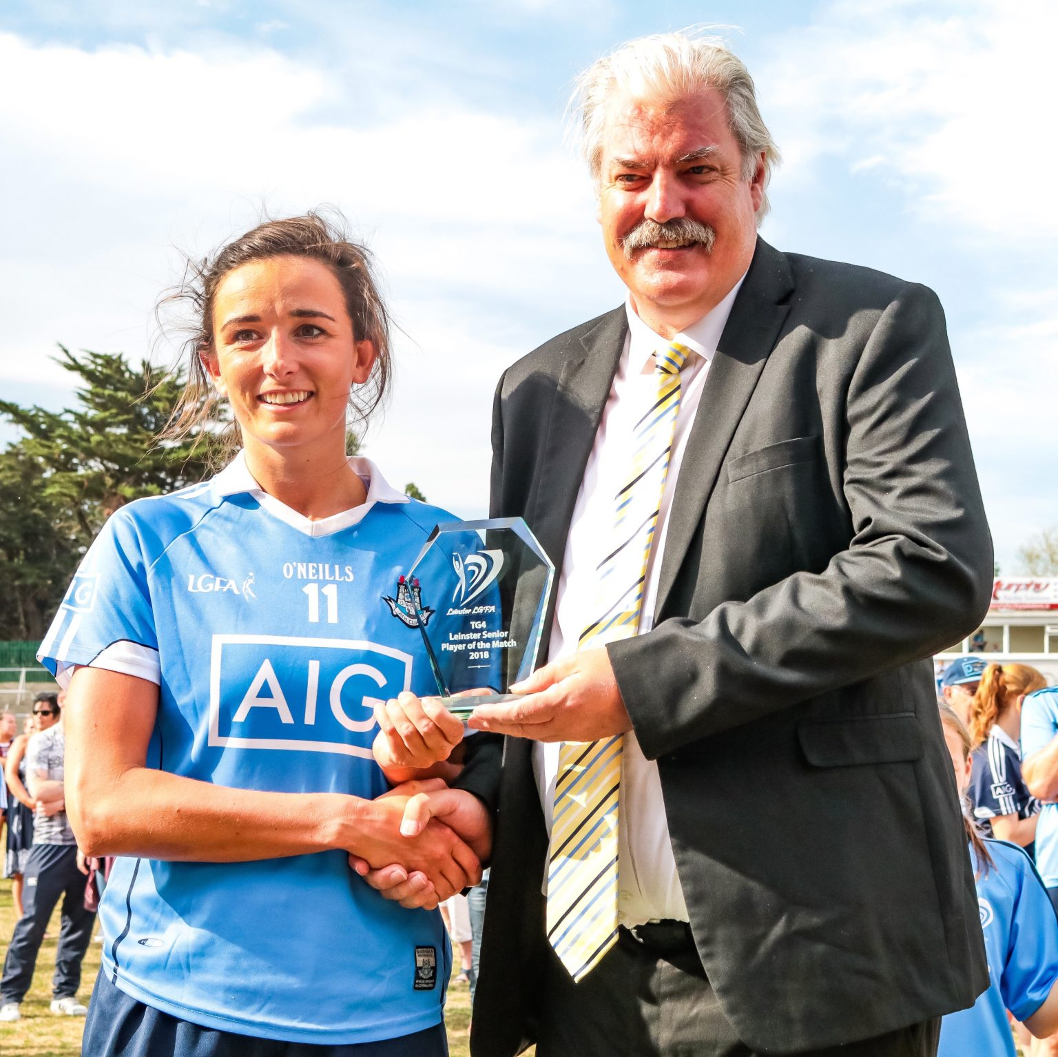 Dublin's Niamh McEvoy Is Presented With Her Player Of The Match From Leinster LGFA President Dominic Leech