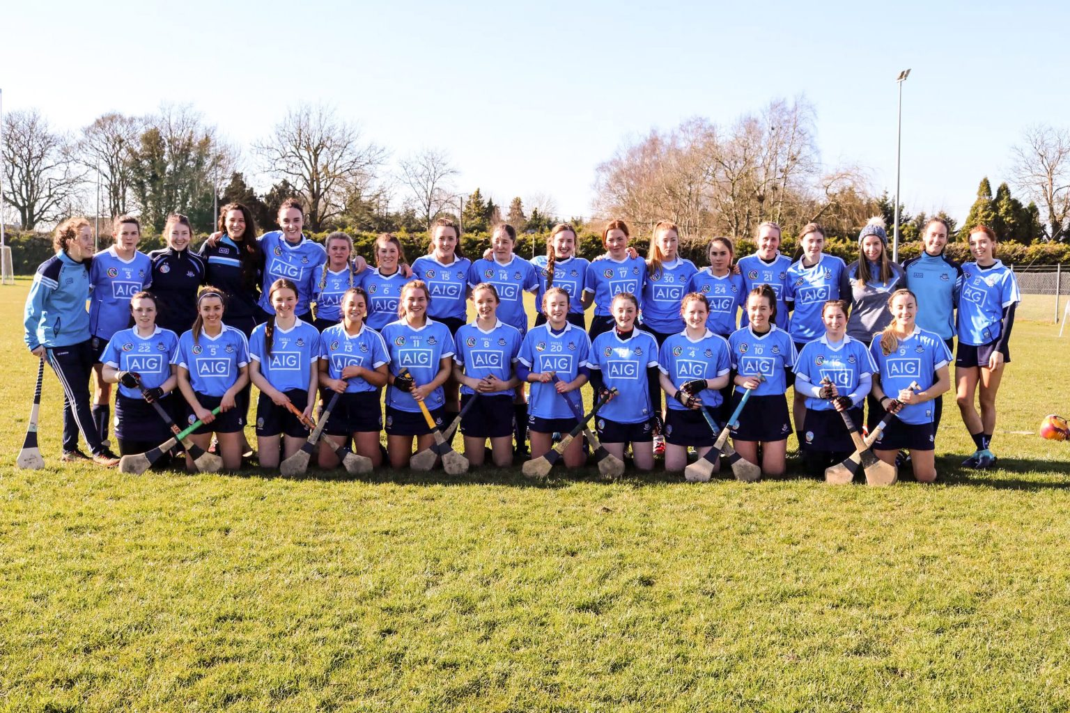 Squad photo of the Dublin Premier Junior Camogie Squad in sky blue jerseys and navy skorts who will claim an All Ireland championship semi final spot with victory over Roscommon