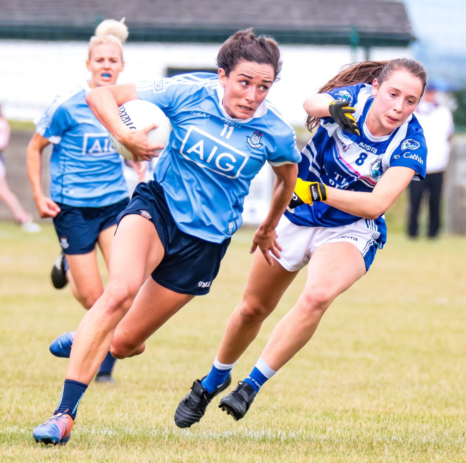 Dublin Ladies Footballer Niamh McEvoy in a sky blue jersey one of the goal scorers in yesterday's win over Cavan, Niamh is seen breaking away with the ball from a Cavan player in a dark blue jersey with white band