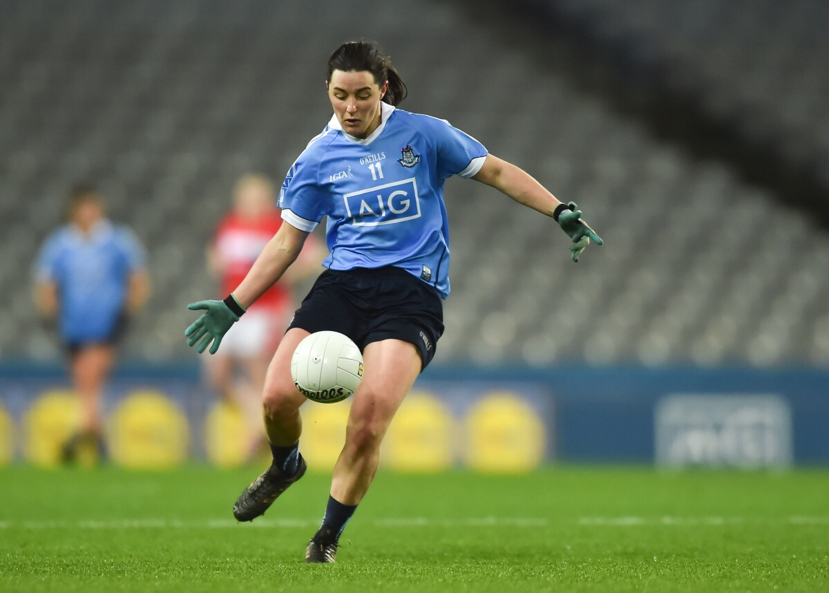 Dublin's Firefighting Forward Lyndsey Davey in a sky blue jersey kicking a white ball
