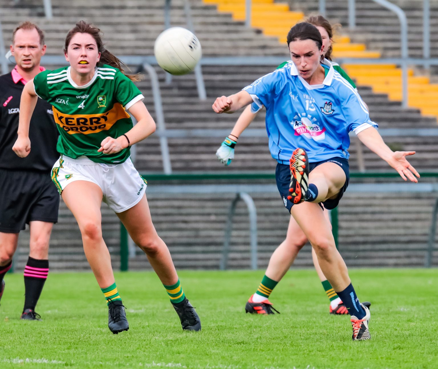 Dublin Ladies Footballer in a sky blue jersey and navy shorts kicks a second half point against Kerry