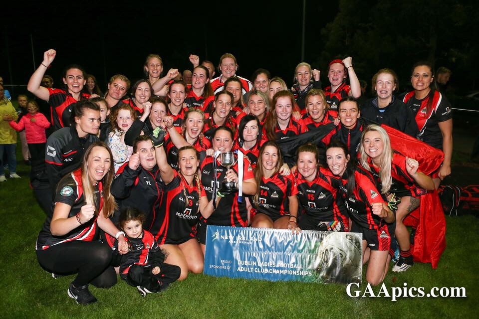 Wanderers Ladies football team celebrating after winning the Dublin LGFA Junior F Ladies Football Title