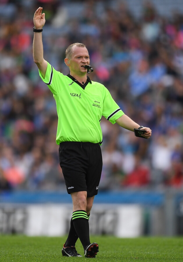 Garryowen McMahon in yellow top and black shorts and socks is named as one of the referees for this year's TG4 All Ireland Finals