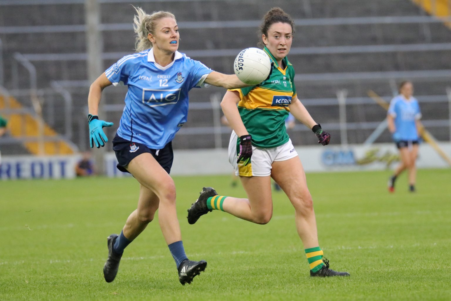 Dublin Ladies footballer in a sky blue jersey and navy shorts running with the ball believes Dublin are in a good place heading into quarter final