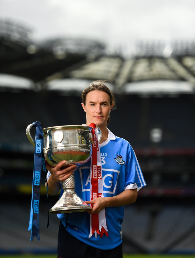 Dublin Ladies Football Captain Aherne in a sky blue jersey holding the Brendan Martin Cup