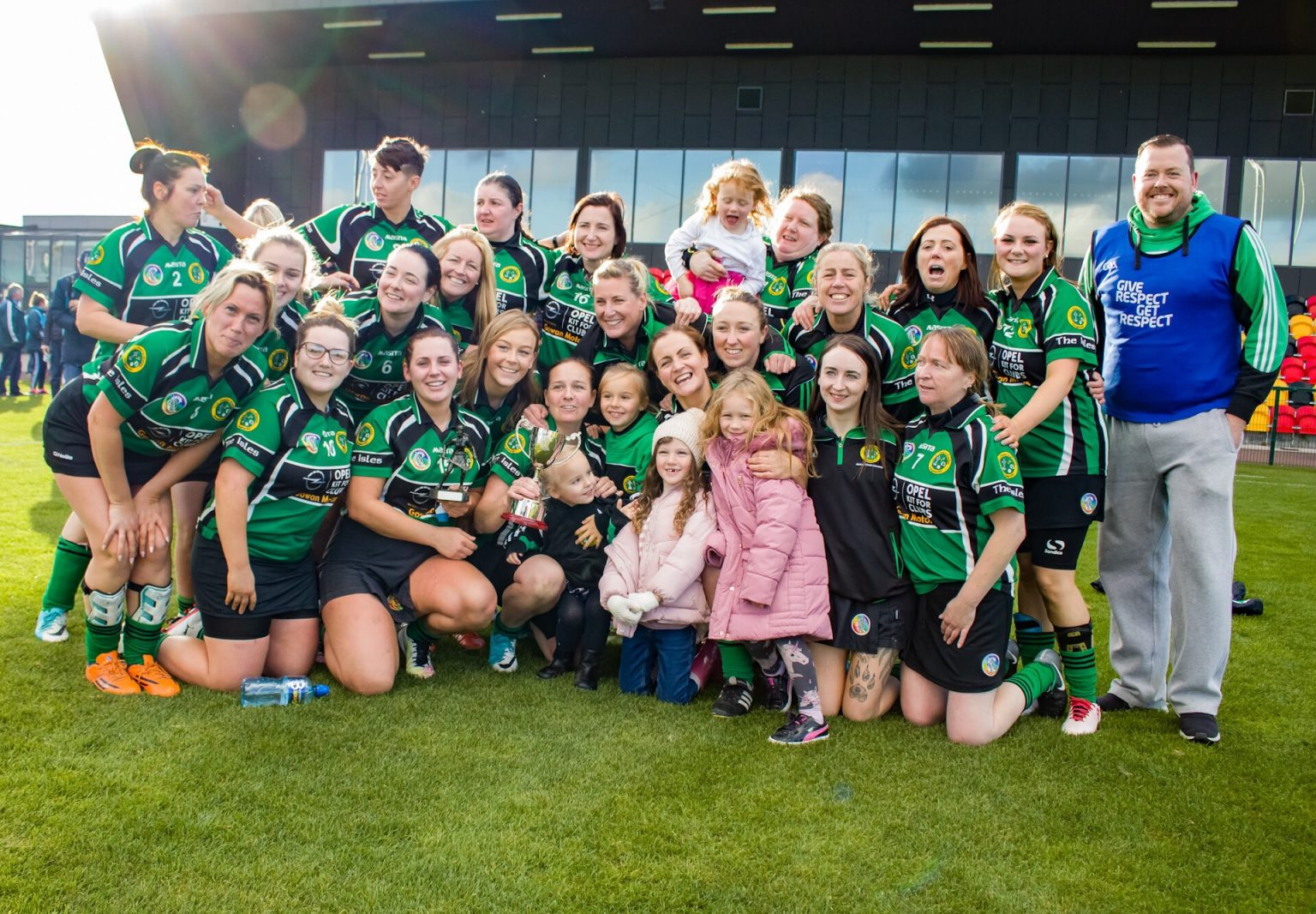 The Erins Isle Camogie Squad Celebrate winning the Junior 4 title after their winning participation in the club championship finals