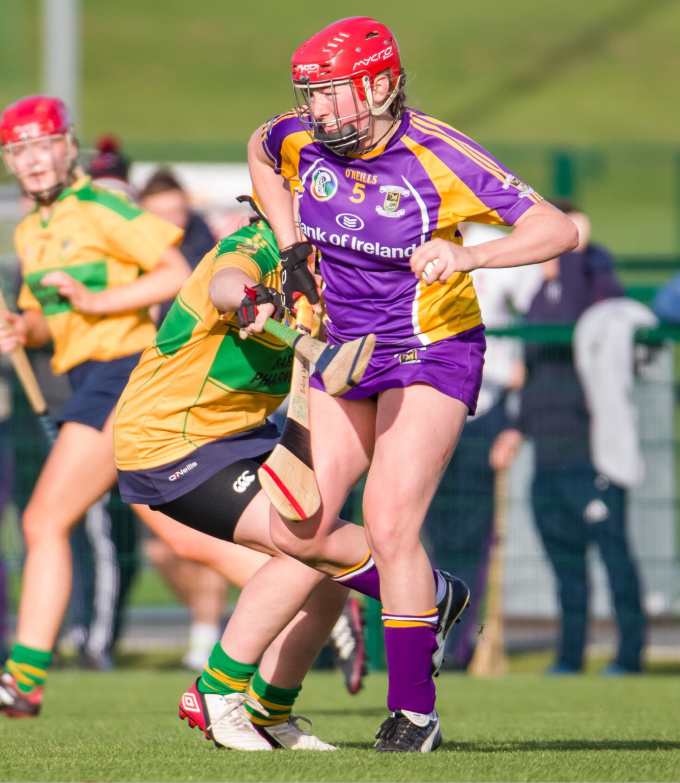 A Kilmacud Crokes camogie player comes out of defence with the ball during the senior 2 club championship final