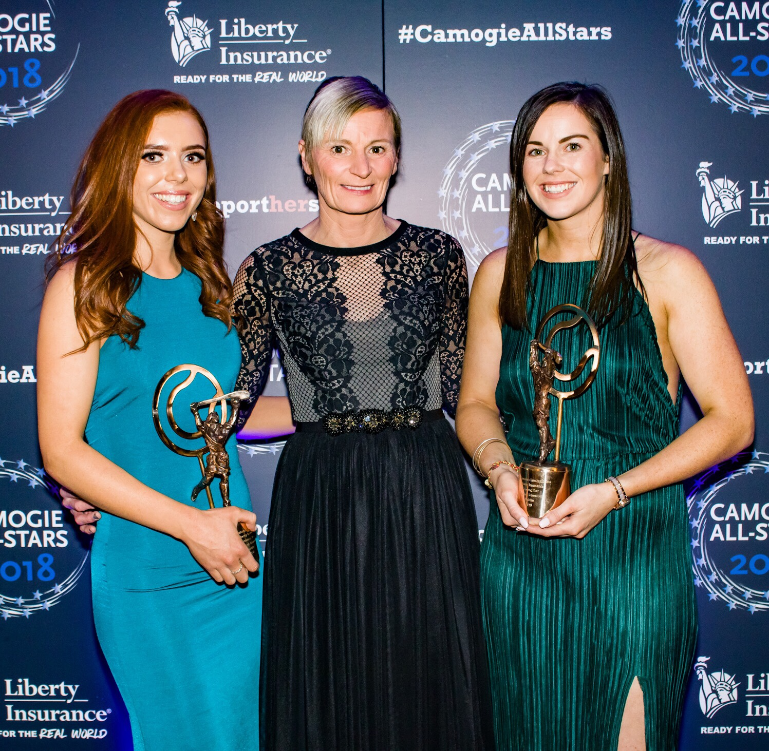Dublin Camogie Players Caragh Dawson and Deirdre Johnstone pose with Dublin Chairperson Jenny Byrne with the trophy's they won at the Camogie All-Stars