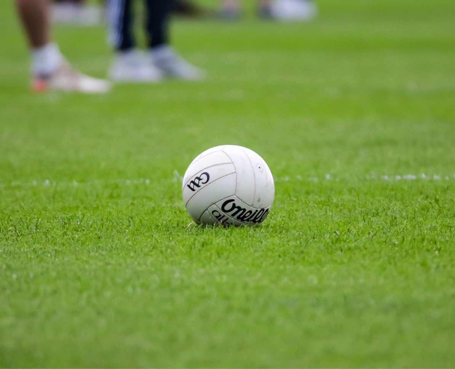 A white football on a grass pitch at an All Ireland Club Game