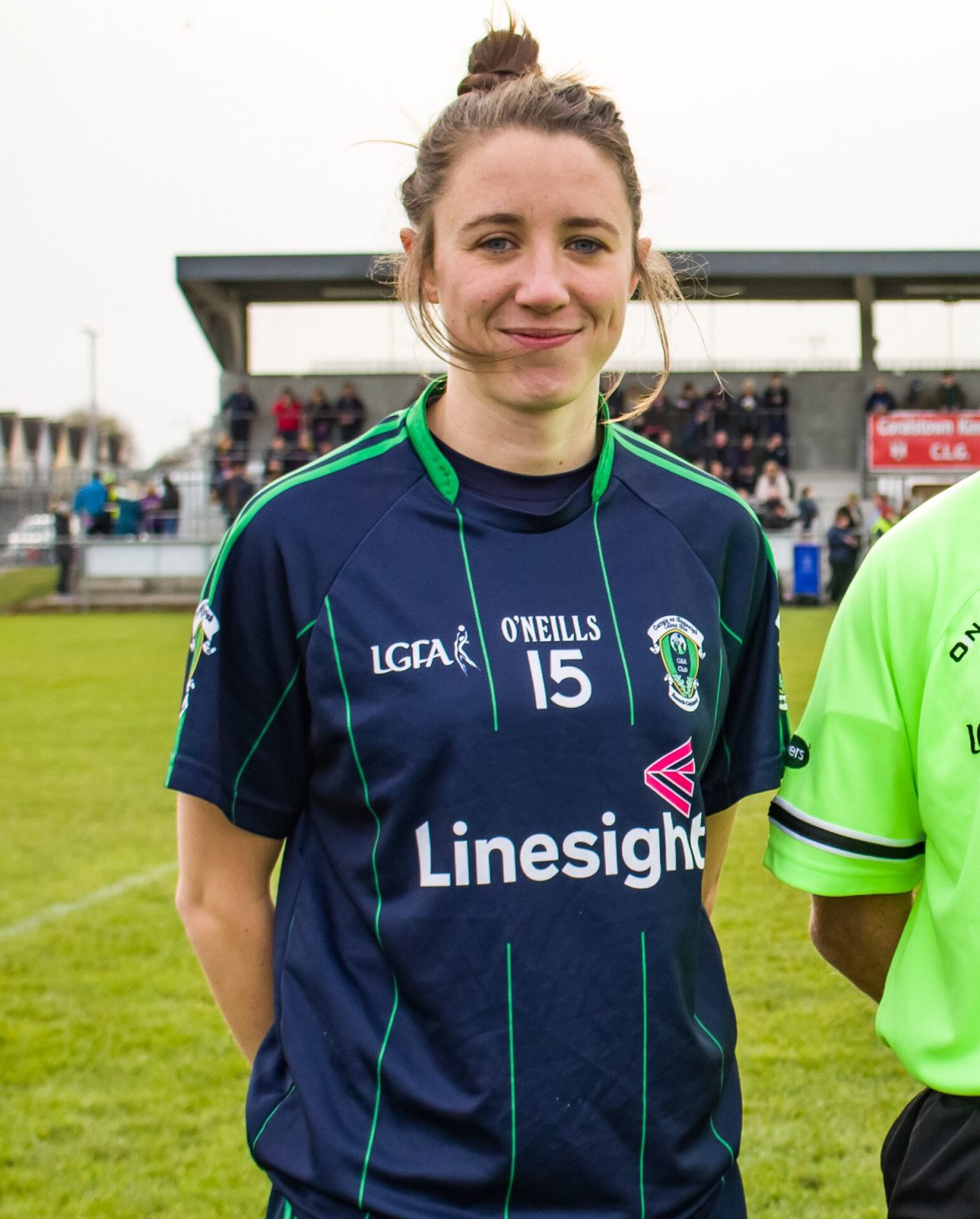 Foxrock Cabinteely Captain Amy Ring In a Navy Jersey with green pinstripes was forced to end her Dublin Career because of knee injury