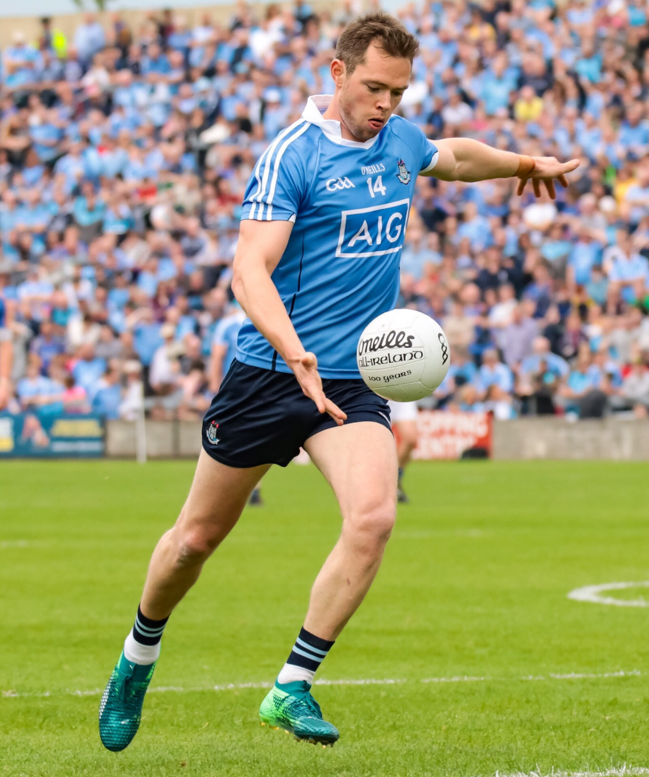 Dublin footballer Dean Rock in a sky blue jersey and navy shorts about to kick a white football