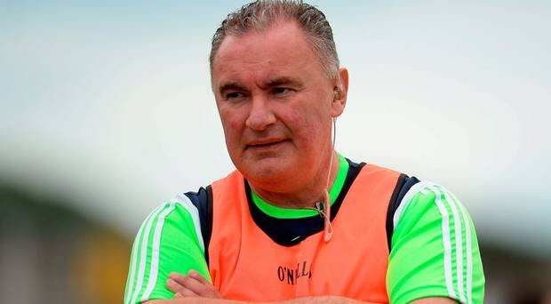 Frank Browne in a yellow bib and lime green top has been named as the new Dublin Senior Camogie Manager
