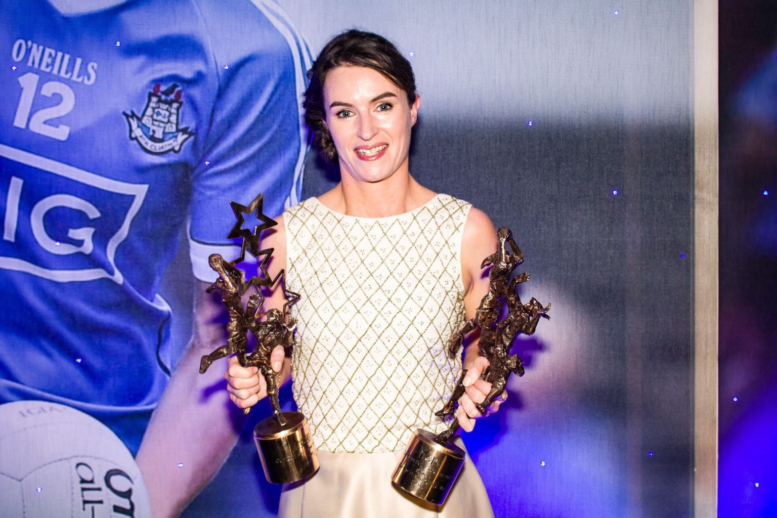 Dublin Captain Sinead Aherne In a white dress holding her All Star and Players' Player Of The Year Awards At The All Stars Awards Night In The Citywest Hotel Last Saturday Night
