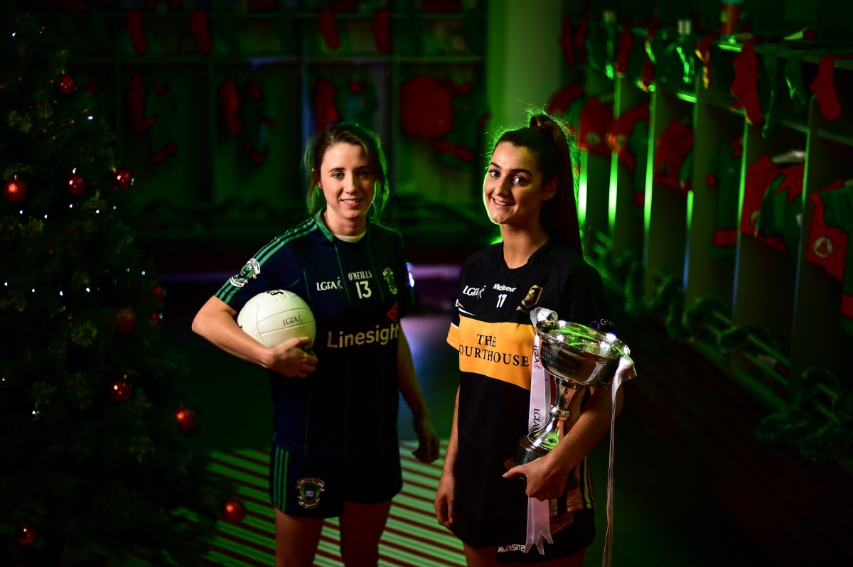 Eimear Meaney of Mourneabbey with the Dolores Tyrrell Memorial Cup, right, and Amy Ring, captain of Foxrock-Cabinteely, ahead of the Senior Ladies All-Ireland Club Final, during the 2018 All-Ireland Ladies Club Football Finals Captains Day at Croke Park in Dublin.