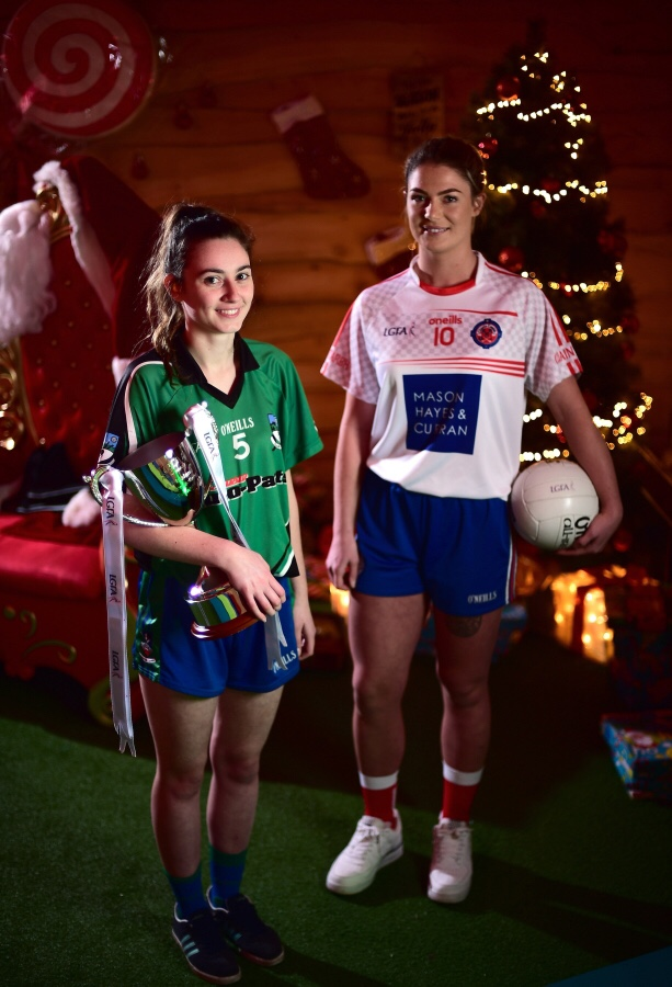 Captains, Sarah Murphy of Clontarf, right, and Nicole Rooney of Emmet Óg with the Ladies All-Ireland Intermediate Club Trophy during the 2018 All-Ireland Ladies Club Football Finals Captains Day at Croke Park in Dublin.