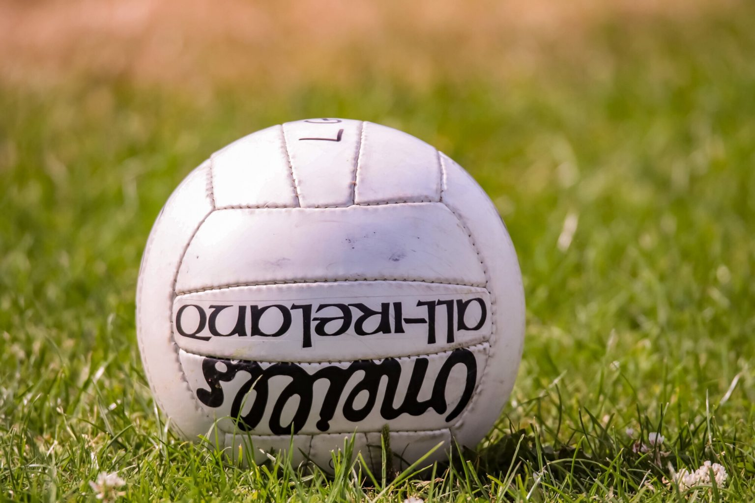 A white Gaelic football on a grass pitch as the GAA announce that the controversial 3 hand pass limit rule has been scrapped