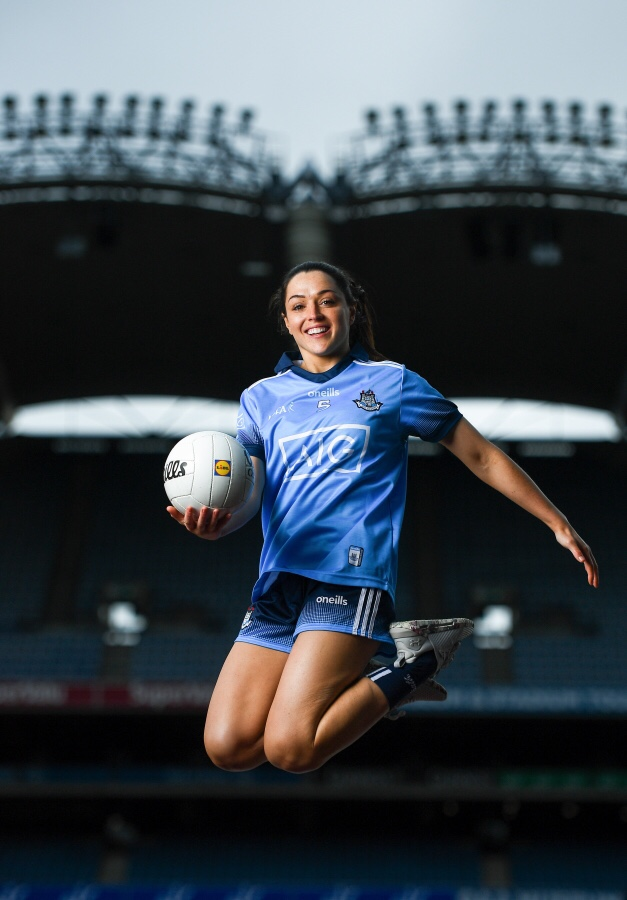 Pictured is Lidl Ireland Ladies Gaelic Football Association Ambassador Sinead Goldrick in a sky blue jersey leaping in the air with a ball in her hand at the announcement of Lidl's plans for their their fourth year of partnership with the Ladies Gaelic Football Association, at the 2019 Lidl Ladies National Football League launch.