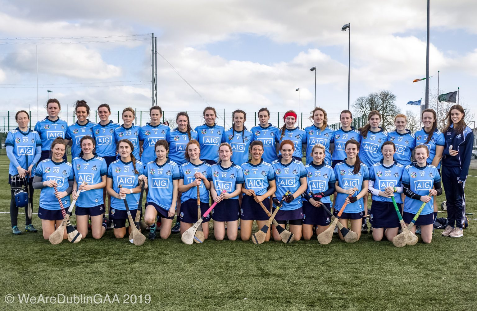 The Dublin Camogie Senior team in sky blue jerseys and navy skorts pose for a squad photo ahead of a league game