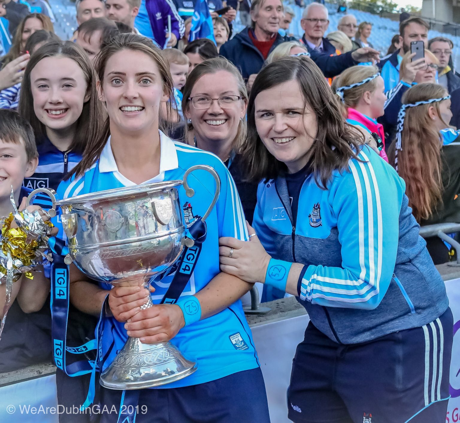 Dublin Ladies footballer Oonagh Whyte in a sky blue jersey and navy shorts and Dublin selector Sorcha Farrelly pose for a picture with the Brendan Martin Cup On the Croke Park pitch