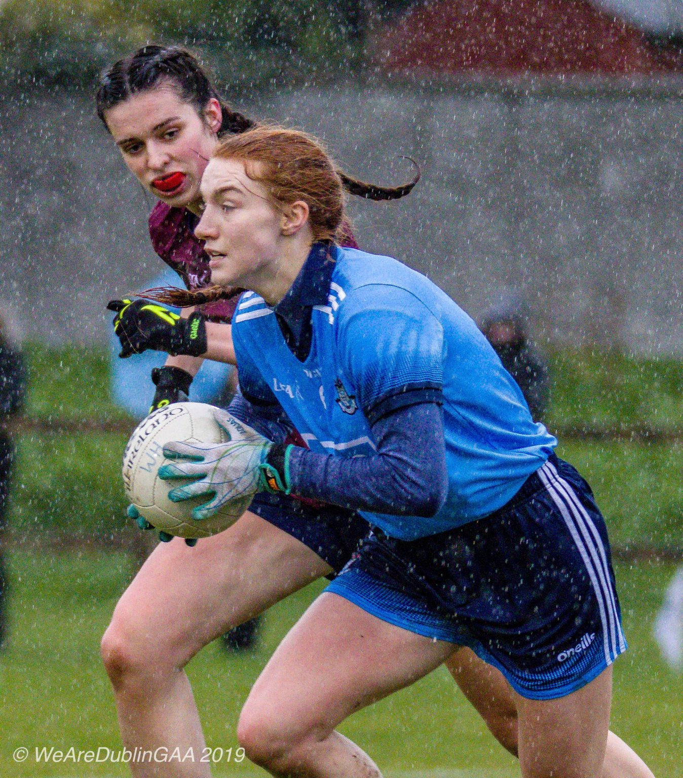 Dublin Ladies Footballer in a sky blue jersey and navy shorts breaks away with the ball during the Lidl National Football League