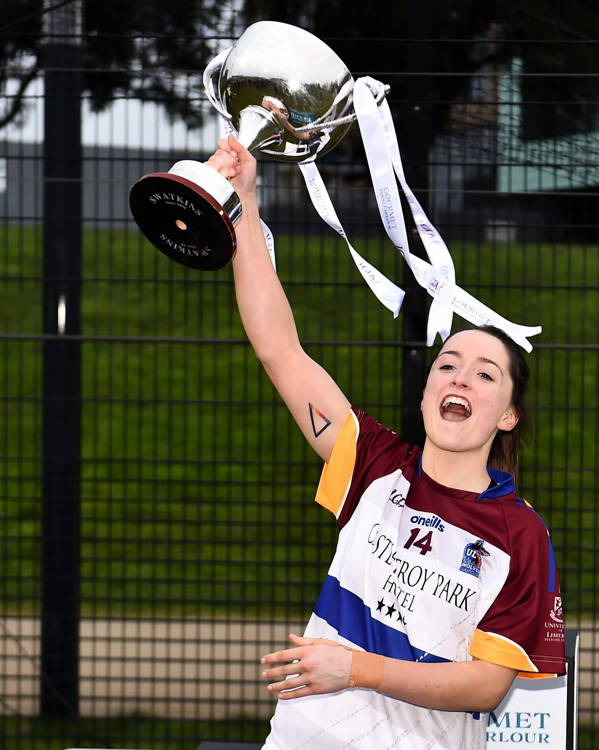 UL Captain in a white jersey with maroon sleeves lifts the O'Connor Cup