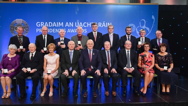 Kathleen Colreavy in a white dress third from the left in the front row among the winners of a GAA President Award.