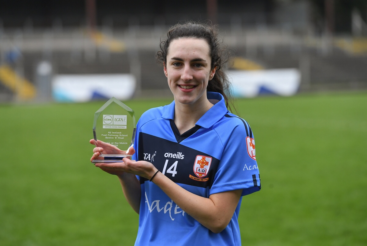 St Pat's Ladies footballer Orlagh Gavin in a light blue jersey with a navy band holds her player of the match award after the Lidl Post Primary School B Final