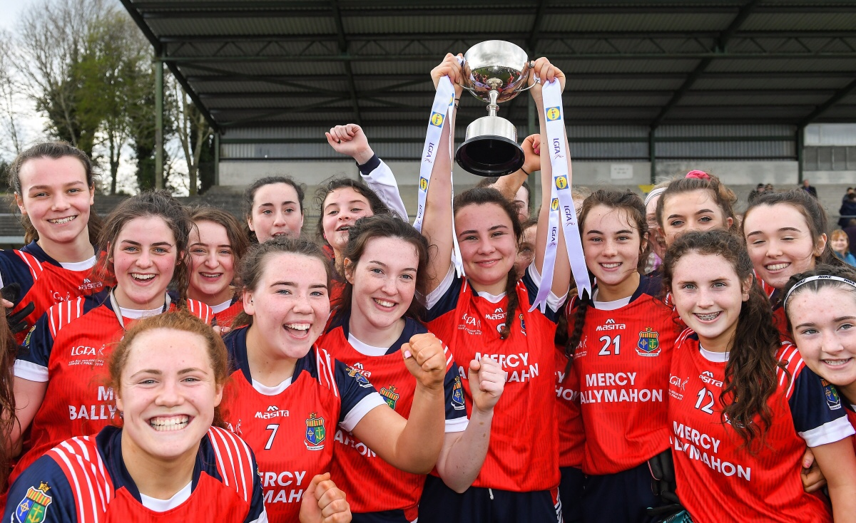 Mercy SS Ballymahon Players In red jerseys with navy and white sleeves celebrate with the cup after winning the Lidl All Ireland PPS Senior C Title