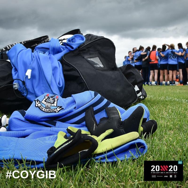 Sky blue Dublin tips on a grass pitch with the Dublin U16 Ladies Team in the background