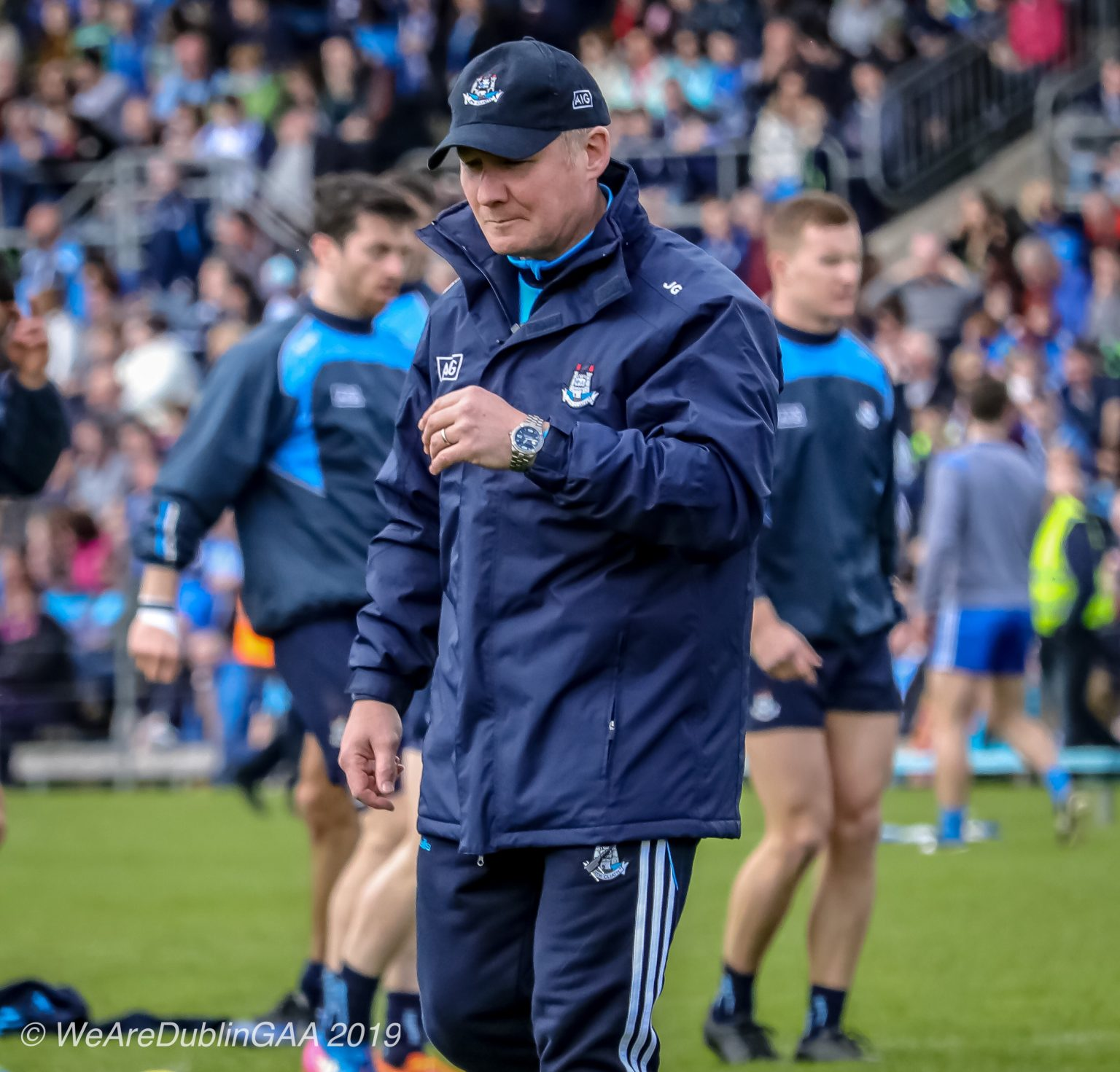 Dublin Football manager Jim Gavin in a Navy jacket, bottoms and baseball cap with the Dublin crest believes Gaelic football is just one rule change from becoming Aussie Rules Football