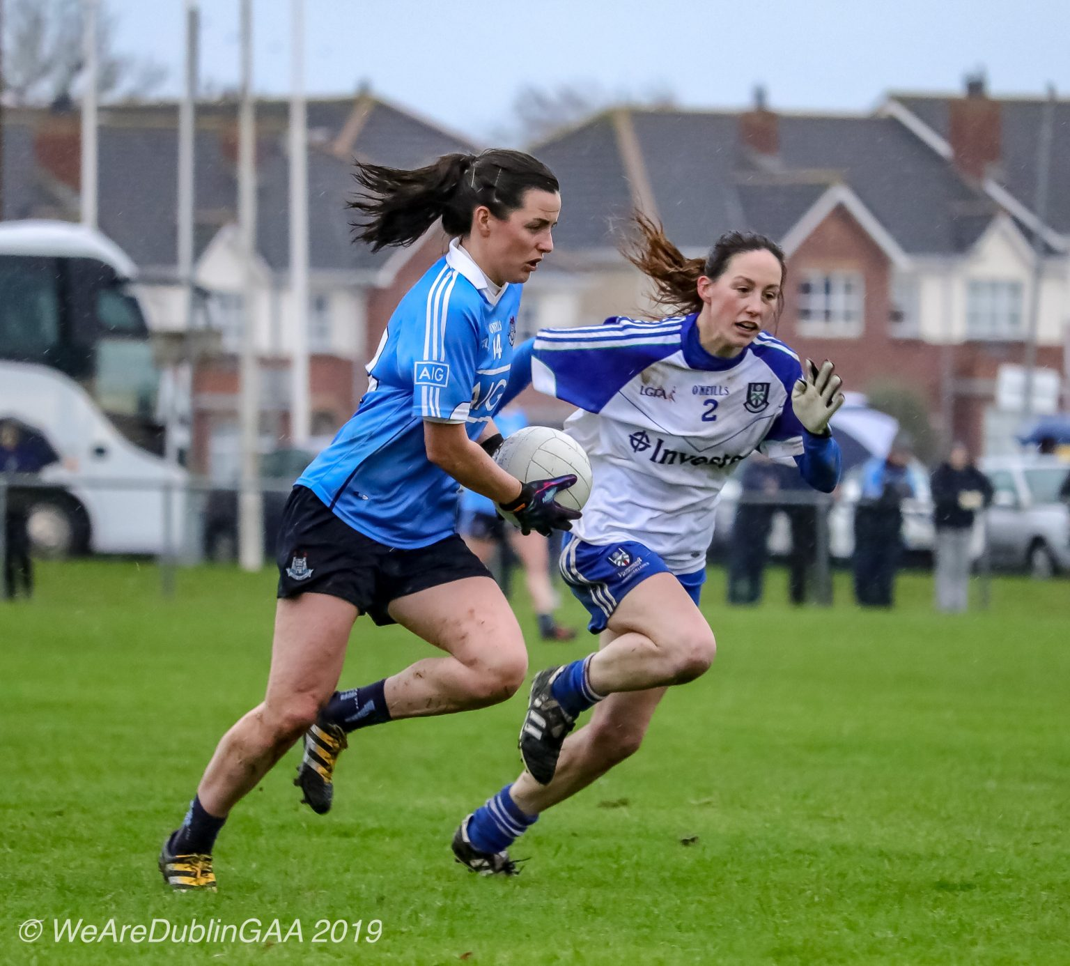 Dublin Ladies footballer in a sky blue jersey and navy shorts accelerates past a Monaghan player in a white jersey with blue sleeves and blue shorts, both teams meet each other this weekend in a Lidl National Football League Round 5 Fixture